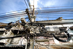 Thailand_142 (jjay69) Tags: city vacation holiday thailand outside outdoors dangerous asia southeastasia wiring outdoor bangkok cable powerlines metropolis highvoltage badwiring capitalcity khrungthepmahanakorn