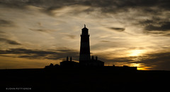 Happisburgh Lighthouse -Explored (John Pettigrew) Tags: sunset sky lighthouse silhouette clouds explore happisburgh explored d7000