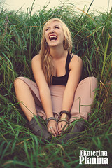 Girl sitting in the grass and laughing.Laughing girl.Enjoyment.Toned in warm colors.Vintage style.Hipster girl. (PlaninaEkaterina) Tags: pink light sunset red summer sky people woman green art nature girl smile look field grass smiling yellow lady laughing vintage happy freedom spring model warm sitting shine wind outdoor hipster young relaxing free lifestyle wave happiness sunny enjoy harmony trendy dreams blonde hippie toned enjoyment