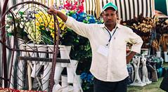 (Dunez Photography & Design) Tags: flowers plants man festival garden spring waiting fuji indian exhibition saudi arabia fujifilm service worker riyadh saudiarabia xe2