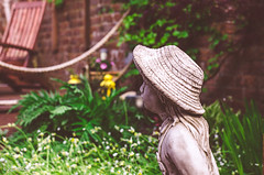 Garden Assistance! (BGDL) Tags: lightroomcc nikond7000 bgdl niftyfifty odc afsnikkor50mm118g statue littlegirl garden cap