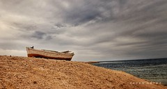 Out Of Place .. (Hazem Hafez) Tags: boat sea sand redsea egypt hurghada sharmaelnaga wind storm clouds sky