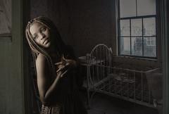 Empty Nest (Cindy_Clicks) Tags: woman sad grief heartbroken loss cradle slum