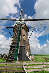 The Twelve Sided Lijkermolen 2 (ShutterBasset) Tags: windmill grass portrait fence bricks lijkermolen polder netherlands holland southholland nikon d5200 tokina1120 cokin