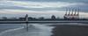 View across the Mersey (Brian Negus) Tags: seaside cranes lighthouse sand newbrightonlighthouse merseyside water docks rivermersey beach wallasey newbrighton reflection liverpool
