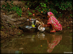 Colours of India (mala singh) Tags: pond woman water india bengal village