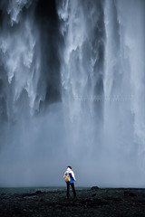 Flow of life (FredConcha) Tags: skogafoss icelan nature cliffs power man alone iceland fredconcha nikon d800 waterfall rocks landscape