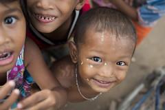 War Painted (Scott Rotzoll) Tags: asia cambodia kampuchea khmer boy smile children playing travel photos portrait eyes nikon