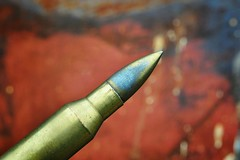 """Crime"" (holly hop) Tags: crime bullet gun violence abstract graffiti macro macromonday rusty"