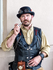 Steampunk Man (J Wells S) Tags: steampunkman bowlerhat pipe smoking vest beard portrait candidportrait 2017internationalsteampunksymposium crowneplazahotelsuites blueash cincinnati ohio dressup costume goggles explore inexplore