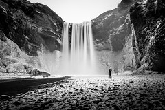 Frozen At Skogafoss (Mabry Campbell) Tags: longexposure blackandwhite bw snow man ice water canon landscape person photography eos photo waterfall iceland europe photographer image f45 photograph le april 100 scandinavia campbell skgafoss mabry skogafoss 17mm southiceland ef1740mmf4lusm 2013 southerniceland 50sec eos5dmarkiii mabrycampbell mabrycampbellcom april132013 201304130h6a0505