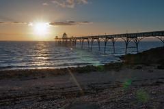 Star light (The Green Album) Tags: light sunset sea sun beach water architecture clouds pier horizon victorian pebbles rays clevedon