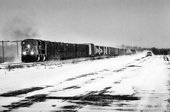 Train vs. Car (Greg Forcey) Tags: adversity aquatic auto automobile autos blackwhite blackandwhite car cars climate cold desolate desolation frigid horizontal horizontals hydro landtransportation landscape landscapes locomotive monochrome motorcar outdoors outside overcast perspective railroad railway railwaylocomotive road roads scenic scenics shade snow snowstorm snowstorms storm stormfront storms stormy train trains vehicle water weather winter