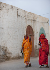 Women Walking In The Street, Massawa, Eritrea (Eric Lafforgue) Tags: africa street travel people vertical walking outdoors photography togetherness town alley women day adult fulllength citylife 2people twopeople domesticlife adultsonly traditionalculture massawa eritrea hornofafrica eastafrica traditionalclothing realpeople traveldestinations colorimage eritreo buildingexterior erytrea eritreia colourimage africanethnicity  massaoua ertra    eritre eritreja eritria builtstructure coastalfeature  rythre africaorientaleitaliana     eritre eritrja  eritreya  erythraa erytreja     ert7093