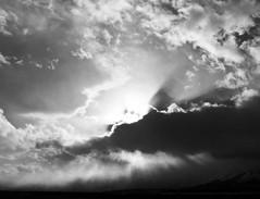 Glory rays (CNorthExplores) Tags: park travel autumn sunset sky bw usa sun white black clouds canon grand national wyoming teton g11