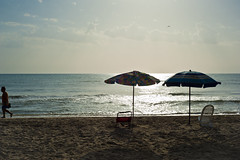 Basta, me ne vado! (luca_pictures) Tags: sea summer two sun beach water 50mm sand alone deckchair gone adriatico beachumbrella albaadriatica
