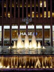 (Shane Henderson) Tags: newyorkcity newyork water fountain sign architecture night lights manhattan columns rockefellercenter chase 1251 midtownmanhattan exxonbuilding