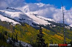 Three Needles Autumn Snow (Brian Kerls Photography) Tags: travel autumn trees winter sky snow storm mountains color fall nature clouds rural forest landscape colorado seasons fallcolors colorphotography peak alpine peaks aspen ridgway sanjuanmountains relic fineartphotography ouray westernus threeneedles