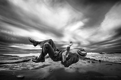 Falling Asleep At The Beach (R.E. Barber Photography) Tags: ocean california morning light sleeping shadow beach water hat birds composite clouds blackwhite high sand shoes waves tide floating levitation windy overcast lajolla suit fedora asleep damp hover riptides multipleimages turbulent photoshopcs6 pentaxk3 rebarberphotography