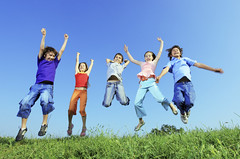Group of five happy children jumping outdoors. (escola.jerusalem) Tags: blue boy summer sky people green girl up field grass childhood sport horizontal youth children fun outside happy kid spring big team jump jumping friend colorful child play friendship outdoor many five joy group young meadow lifestyle happiness copyspace tween joyful adolescent playful leaping active upward caucasian