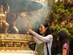 Taipei prayer (M.Bob) Tags: china city light sunset woman girl beauty asian temple golden child buddhist capital religion praying chinese taiwan peaceful buddhism taipei tradition traditionalculture placeofworship chineseculture aisa incensesticks religiosity