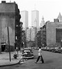 Lower Manhattan in the good old days. The World Trade Center hovers over unrestored 19th century tenements. Litter fills the street and a stripped Volkswagen Beetle is illegally parked at a fire hydrant. New York. June 1979. (wavz13) Tags: oldphotographs oldphotos 1970sphotographs 1970sphotos oldphotography 1970sphotography vintagephotographs vintagephotos vintagephotography filmphotos filmphotography newyorkphotographs newyorkphotos oldnewyorkphotography oldnewyorkphotos vintagenewyork vintagemanhattan vintagenewyorkphotography vintagenewyorkphotographs vintagenewyorkphotos oldworldtradecenter vintageworldtradecenter twintowers originalworldtradecenter oldbuildings vintagebuildings 19thcentury oldconstruction vintageconstruction depressing bleak noir noire dark urbanphotography urbanphotos urbanscenes cityphotography cityphotos vintagecars vintagecar oldcar oldcars 1960scars 1970scars collectiblecars collectablecars manhattanskyline newyorkskyline newyorkskyscapers manhattanhistory newyorkhistory 1970smanhattan 1970snewyork oldnewyork oldmanhattan 1970scar rainy gloomy urban grain grainy oldvolkswagens vintagevolkswagens beetles oldbeetles vintagebeetles streetphotos streetphotography tenements oldtenement vintagetenements