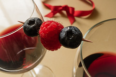 Enjoyment (Hanna Tor) Tags: macro food berry raspberry stilllife kitchen art table macromonday inbetween glass hannator tasty dinner red berries sweet wine blueberry