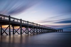 Cloud Sweep (Ralph Cherubin) Tags: olympus ep5 panasonic 12mm32mm february 2017 pier milford ct connecticut walnutbeach beach longislandsound ocean clouds water longexposure sunrise fav25 pb