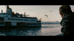 Ferry to Besiktas, Istanbul (emrecift) Tags: candid portrait landscape photography istanbul ferry cinematic 2391 anamorphic grain sony a7 alpha legacy lens canon new fd 50mm f14 emrecift