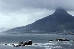 A cloudy day (Michele's POV) Tags: lionshead mountain capetown vista cloudyday city tablemountainrange atlantic rockyoutcrop sunburst monochrome monochromatic shrouded oudekraalview seasidecity