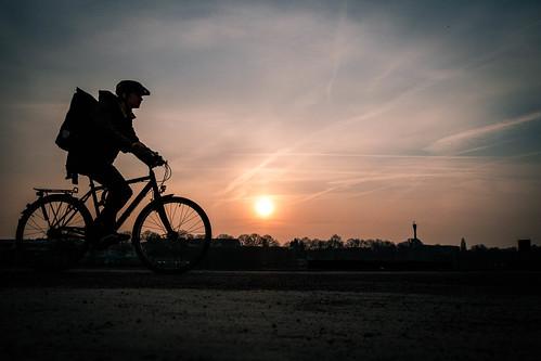 Courier (Dan-Schneider) Tags: streetphotography street silhouette light sunset sun sky mood