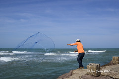 Casting His Net (Jan L. Curtis) Tags: fisherman fishing gulfofmexico jetty spi southpadreisland