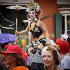 Stilt walker, Mardi Gras New Orleans 2017 (oldrockerward) Tags: bourbonstreet pretty parasol makeup woman nola neworleans mardigras stilts