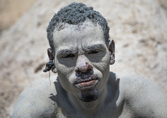 Borana tribe man covered with salt after diving in the volcano crater to collect salt, Oromia, El Sod, Ethiopia (Eric Lafforgue) Tags: adult africa african blackpeople borana colourpicture country crater danger dangerous day developingcountry elsod ethiopia ethiopia0317066 ethiopian ethnic extinctvolcano hardwork head headshot horizontal hornofafrica lake lookingatcamera men naturalphenomenon onemanonly oneperson oromia oromo oromya outdoors poverty protection realpeople resources saline salt saltlake sod toxic tribe volcanic volcano water worker
