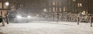 Heavy snowfall makes the steep canal bridges slippery