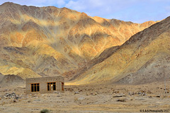 Sun Shades (Simranpreet Singh Gill) Tags: ladakh sunshades window house remote isolated brickhouse mountains sunrays shadow sky blue