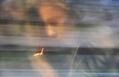 inconsapevoli fuochi (Ro_.) Tags: riflesso finestrino volto mosso
