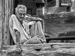 Street Portrait - The older I get, the more I would rather sit alone, in silence, than with people who judge the way I live. (Louay Henry) Tags: nikon nikond610 d610 nikonportrait india oldman streetphotography streetlife streetcandid candidportrait candid streetportraiture portraiture streetportrait portrait man homeless urban outdoor blackandwhite monochrome blackwhite face poor character strangers tamron2470mm tamron lonely alone people