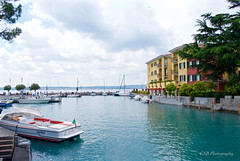 Sirmione, Italy (GSB Photography) Tags: italy lombardy lakegarda sirmione scaligercastle village town harbor lake lakeside water boat clouds nikon d60 aplusphoto
