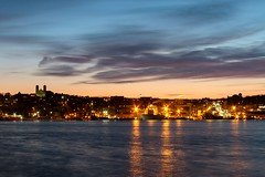 City Lights (Karen_Chappell) Tags: city urban downtown harbour nfld newfoundland stjohns sunste clouds sky ocean avalonpeninsula eastcoast atlanticcanada canada lights longexposure water blue orange silhouette