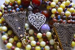colours & fashion 1 (Doctor Ahmed Badr) Tags: art color colour fashion necklace bracelet heart yellow brown blue violet silver metal macro closeup gimp nikond3200