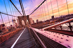 Brooklyn Bridge in New York City (beatricepreve) Tags: new york brooklyn landmark ny nyc view modern downtown america travel river seaport famous scene skyscraper tower usa nobody gate waterfront urban suspension culture cable skyline light east lower tourist manhattan metropolis design architecture city sky scenic bay tourism daytime water bridge structure harbor cityscape sunrise american outdoor