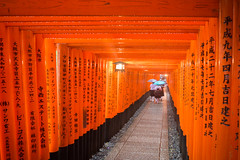 School girls in the path of the thousands torii (koalie) Tags: vacation people rain japan umbrella kyoto shrine inari tunnel jp schoolgirl shinto kyotoprefecture inarifushimitaisha 2013060727japan