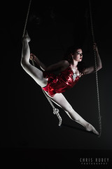 Estlin Love (Chris Rubey) Tags: red studio lowlight edinburgh shadows darkness circus fineart performance performingarts highcontrast editorial leith acrobat bodyart trapeze artificiallighting offcameraflash darkrooms crosslighting estlinlove outofthebluestudios