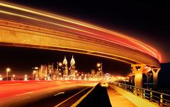 Speed of Light (Charn High ISO Low IQ) Tags: city longexposure nightphotography bridge panorama building highway dubai uae transportation skytrain lightstream palmjumeirah