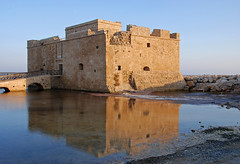 Medieval Castle (ritsa_ch) Tags: castle fort citadel cyprus paphos palace architecture medieval heritage reflection fortress history historic landmark famousplace famous attraction tower symbol brick bridge building daylight sunset dramatic gothic orange military roof scenic symbolic column pillar pillars tourism tourist travel view vintage war windows scenery