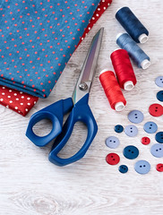 scissors, threads, fabric and buttons on wooden table (♥Oxygen♥) Tags: kit craft tool supplies accessories red darkblue fabric design color set sew sewing scissors white canvas creative handiwork crafty metallic textile closeup clothing table shear cloth trim thread household cutout tailor equipment buttons cutter bobbin measuring texture colorful blue