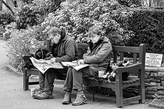 Sunday Papers (sasastro) Tags: streetphotography candid couple reading newspapers park abbeygardens burystedmunds pentaxk5iis