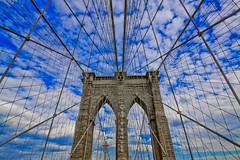 Brooklyn Bridge (Strykapose) Tags: brooklynbridge newyorkcity nyc newyork brooklyn clouds johnaugustusroebling cables perspective outdoor strykapose suspensionbridge tower bridge walkway sky blueskies daytime canon50d vanishingpoint ultrawideangle uwa