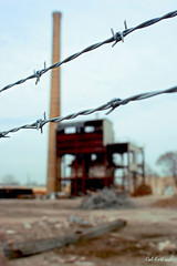 Barbed Wire (calkothrade2) Tags: industrial barbedwire rustybuilding calkothrade smokestack usa